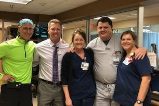 Photo: Chuck Mantooth with ARHS employees