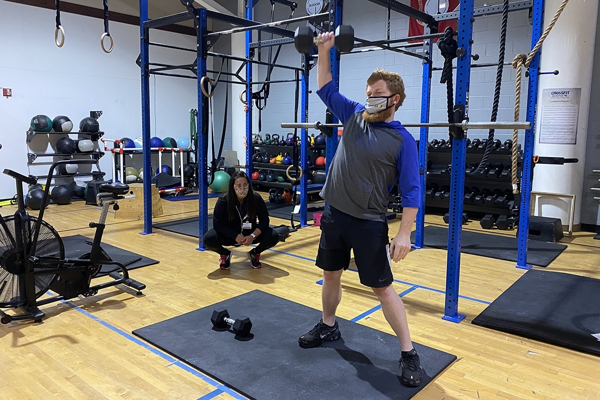 Jackson working out post-surgery while trainer Tiffany coaches