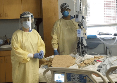 Image: Staff in PPE in COVID patient room